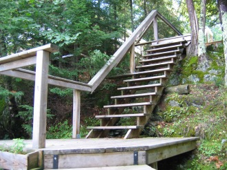 stairs from lake front to cabins